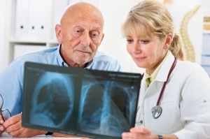 doctor and older man looking over xray